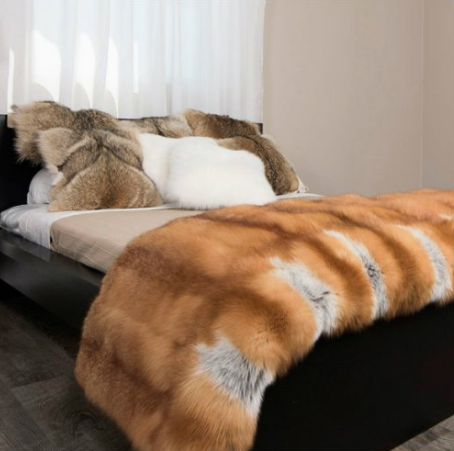 natural-fur-blanket-on-top-of-a-bed